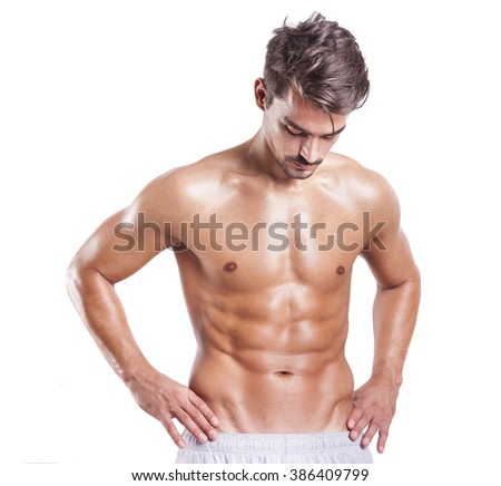 Fit man with beautiful torso on a white background - stock photo