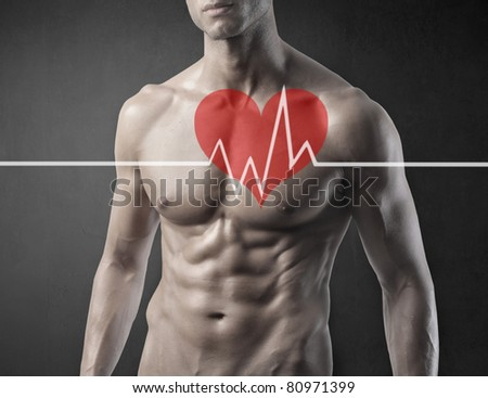 Fit man with ECG graphic - stock photo