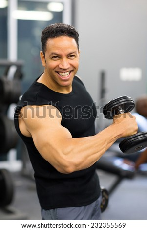 fit mid age man training with dumbbell - stock photo