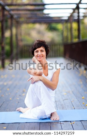 fit middle aged woman portrait outdoors - stock photo