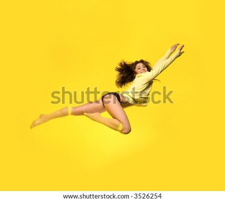 Fit model flying up - stock photo