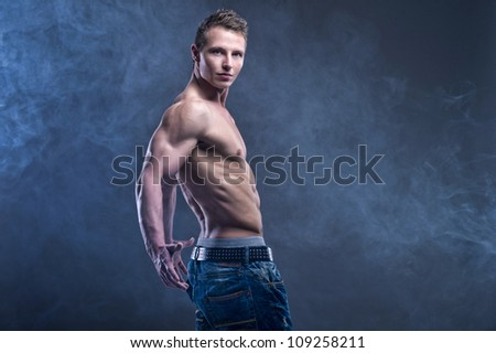 Fit muscular man - stock photo