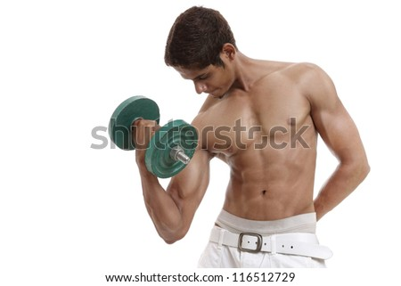 Fit muscular man exercising with dumbbell - stock photo