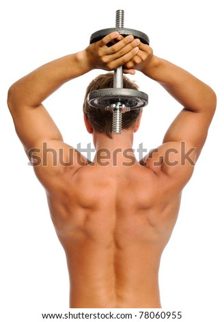 Fit muscular man uses his dumbbell to work his triceps - stock photo