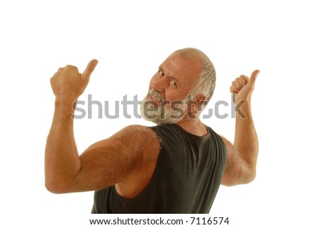 Fit older man in a tank top throwing thumbs up while flexing; isolated on white