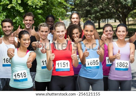 Fit people at race in park on a sunny day - stock photo