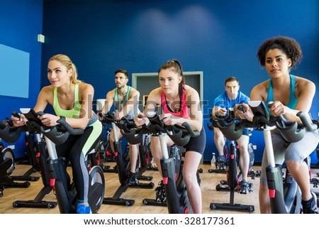 Fit people in a class at the gym - stock photo