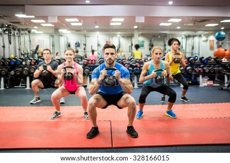 Fit people working out in fitness class at the gym - stock photo