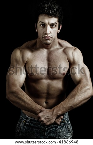 Fit powerful man showing his muscles - stock photo
