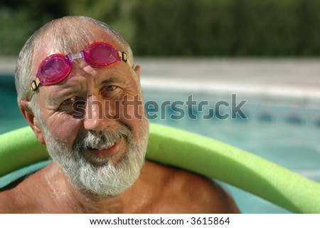 Fit senior man working out in the swimming pool - stock photo