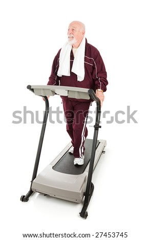 Fit senior man works out on a treadmill.  Full body on white.