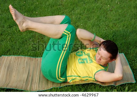 Fit senior woman exercising in a park