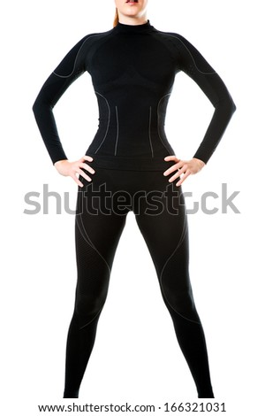 Fit sexy woman in black hot sports thermal underwear for downhill skiing isolated on white background - stock photo
