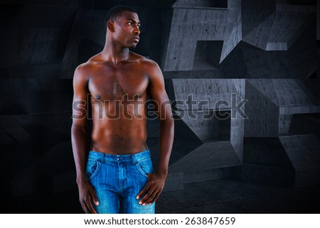 Fit shirtless young man against dark room