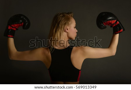 Fit slim young beautiful blonde woman boxing in sportswear. Photo set of sporty muscular female girl wearing sports clothes over gray background