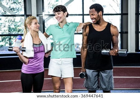 Fit smiling people standing together in crossfit