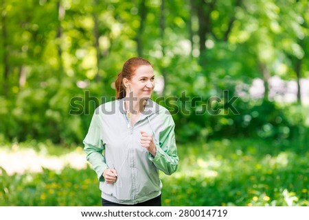 Fit sportive women jogging in the park. Healthy life and fitness concept - stock photo