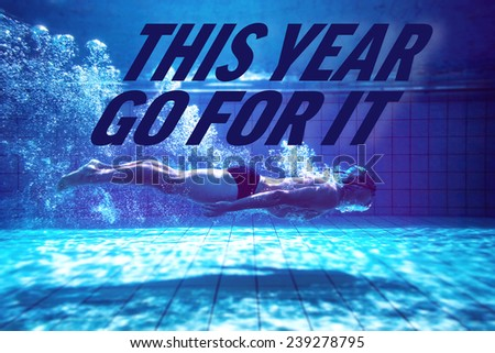 Fit swimmer training by himself against this year go for it - stock photo