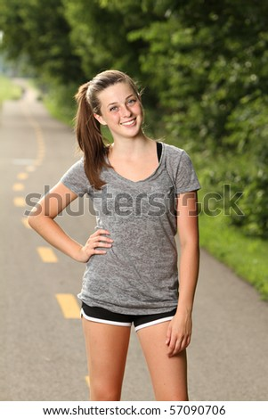 Fit teenager getting ready to workout - stock photo