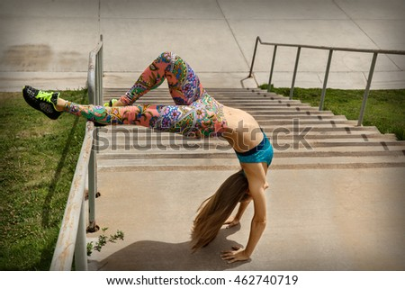 Fit woman doing hand standing on the stairs outdoor