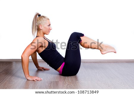 fit woman doing sit-ups exercise abdominal workout - stock photo