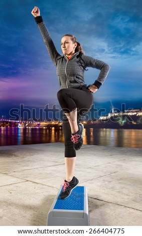 Fit woman exercising on stepper - stock photo