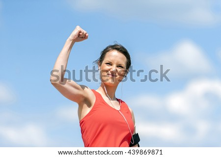 Fit woman happy of victory.