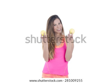 Fit woman holding tennis balls against a white background - stock photo