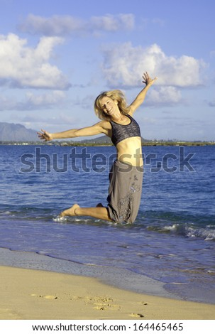 fit woman in her forties on a hawaii beach - stock photo