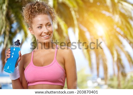 Fit woman in nature.Tropical resort - stock photo
