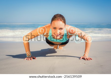 Fit woman in plank position on the beach against fitness interface - stock photo