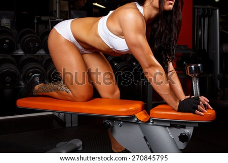 Fit woman in underwear doing exercises in a gym