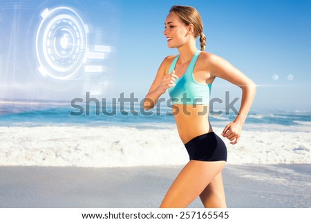 Fit woman jogging on the beach against fitness interface - stock photo