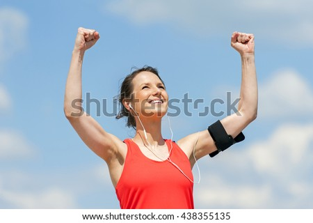 Fit woman jump happy of victory winns. - stock photo