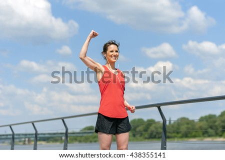 Fit woman jump happy of victory winns.