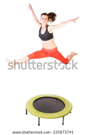 Fit woman jumping on fitness trampoline - isolated on white. - stock photo