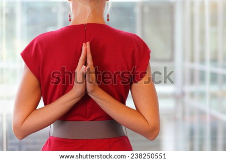 Fit woman - namaste gesture on back - close up - stock photo