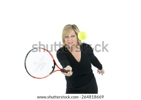 Fit woman playing tennis against a white background - stock photo
