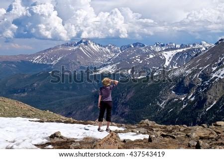 Fit Woman Standing and Enjoying Mountain View.  Trail Ridge road at Rocky Mountains National Park, near Estes Park,  Colorado, USA.  - stock photo