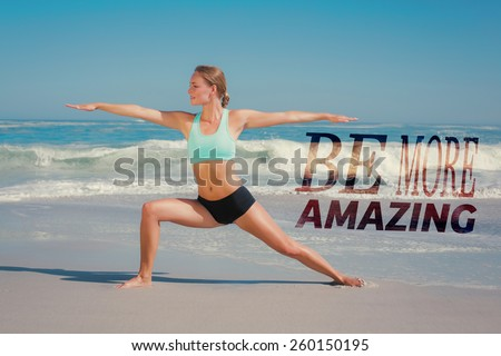 Fit woman standing on the beach in warrior pose against be more amazing - stock photo