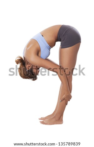 Fit woman stretches her legs, isolated on white background.