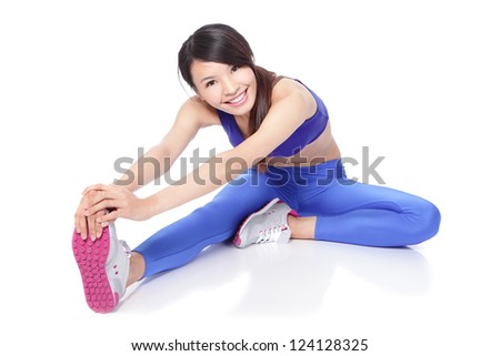 Fit woman stretching her leg to warm up - isolated over white background, asian model - stock photo