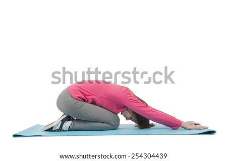 Fit woman stretching on her exercise mat against a white background - stock photo