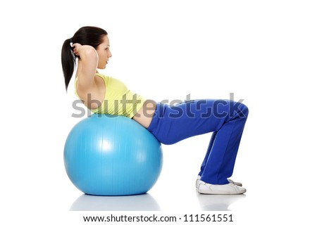 Fit woman with fitness ball , isolated on white - stock photo