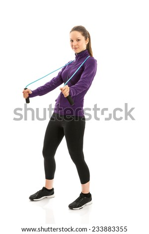 Fit woman with jump rope - stock photo