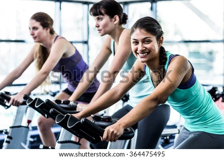 Fit woman working out at class in the gym