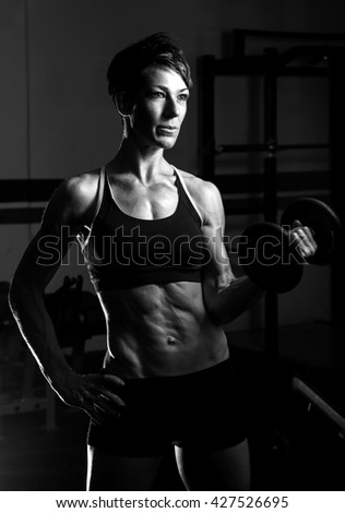 fit woman working out at the gym - stock photo
