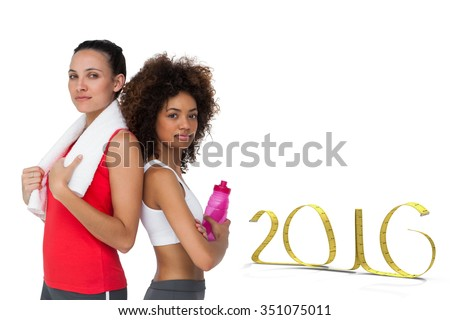 Fit women standing with waterbottle and towel against white background with vignette - stock photo
