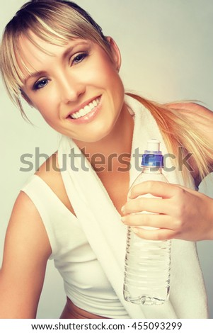 Fit workout woman holding water bottle - stock photo