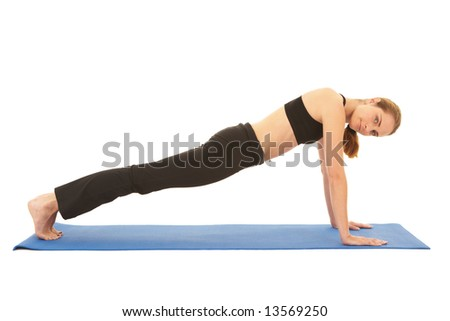Fit young brunette pilates instructor showing different exercises on a white background a blue yoga mat. White background NOT ISOLATED